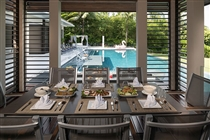 Poolside dining table